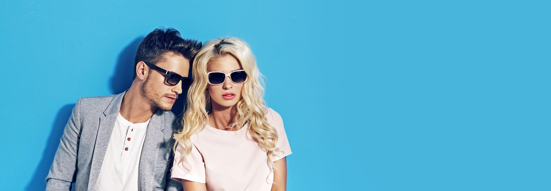 Lady and gent wearing sunglasses